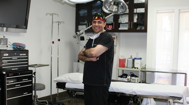 Dr. mark Youssef in his surgery room