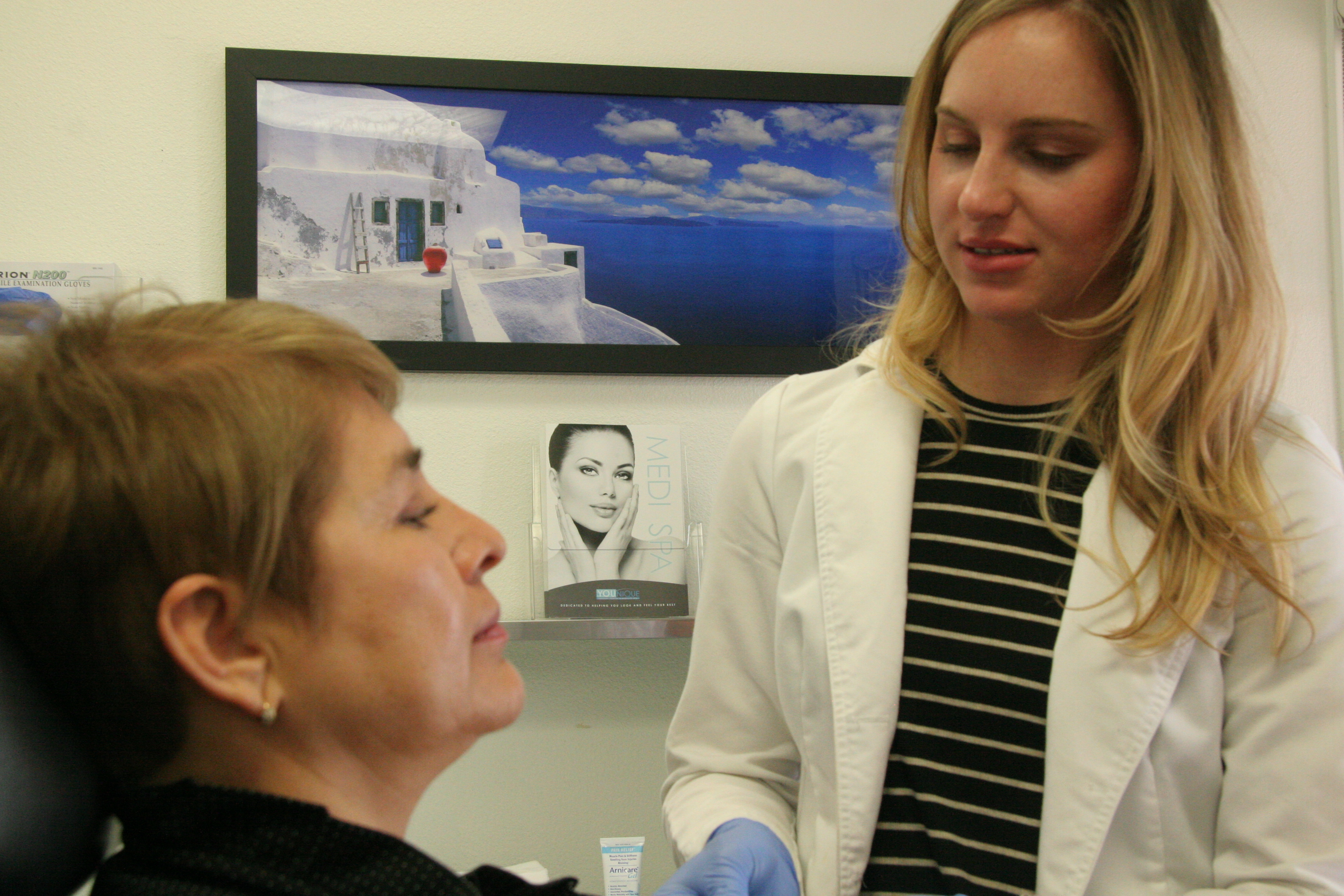 Physicians Assistant working with patient